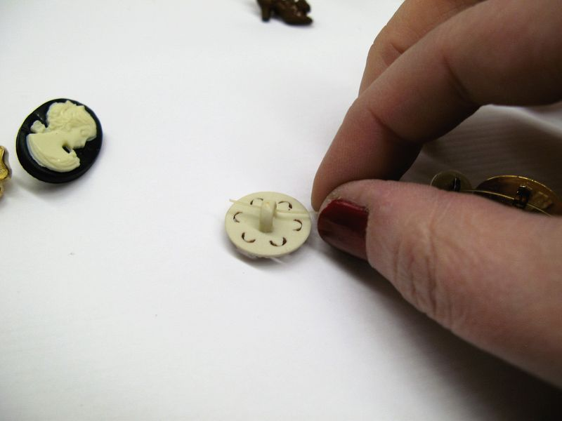 Threading buttons on string