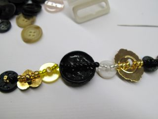 Buttons and beads threaded together