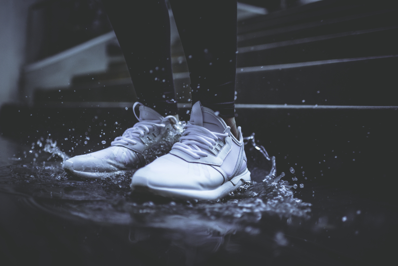 Sneakers in a puddle